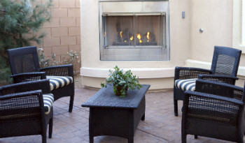 houston outdoor fireplace with chairs and a table