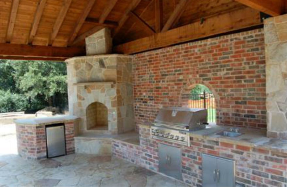 Houston outdoor fireplace project with wet bar kitchen