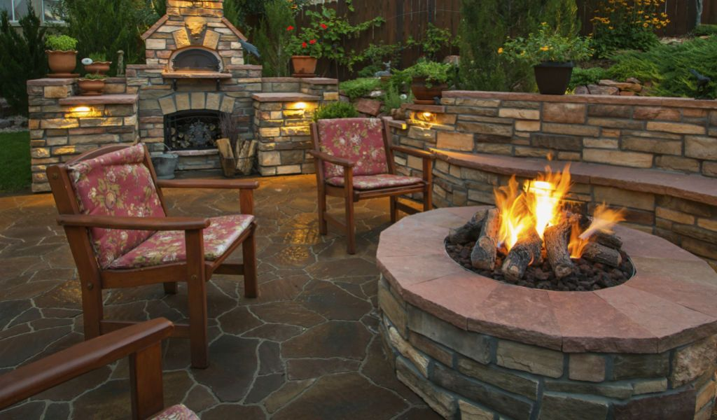 Humble outdoor fireplace and firepit set complete with chairs