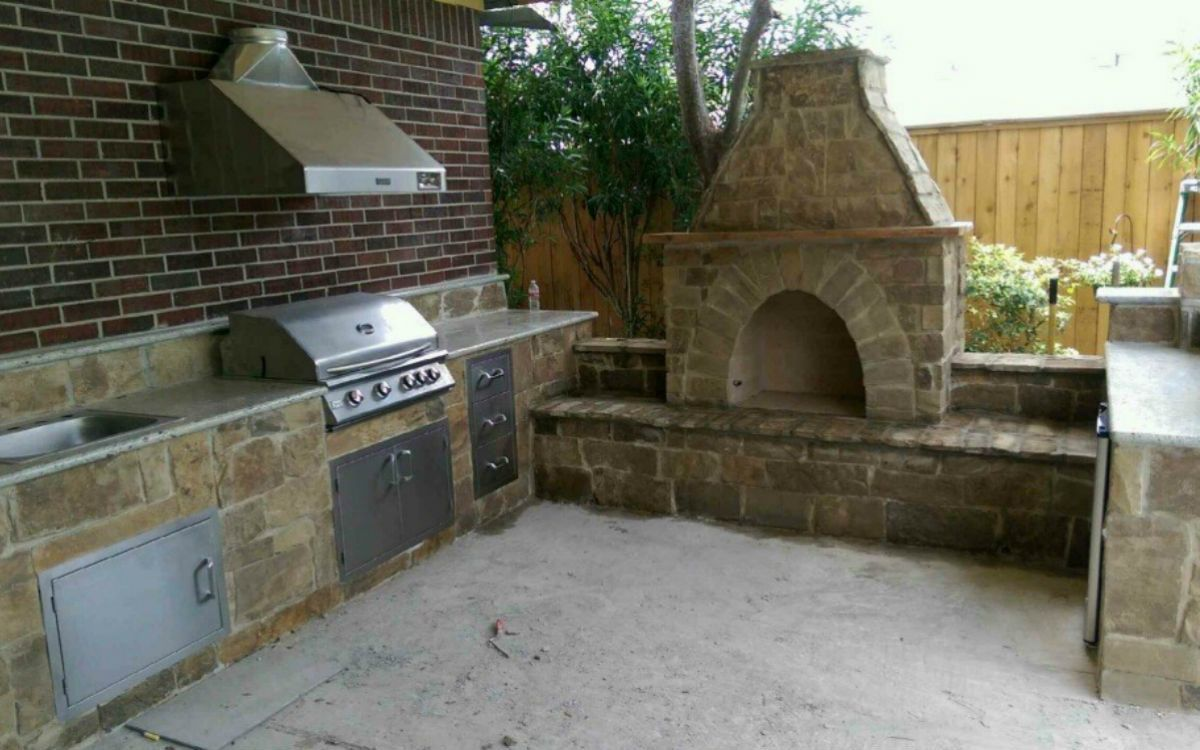 Outdoor kitchen ideas that include a hooded vent