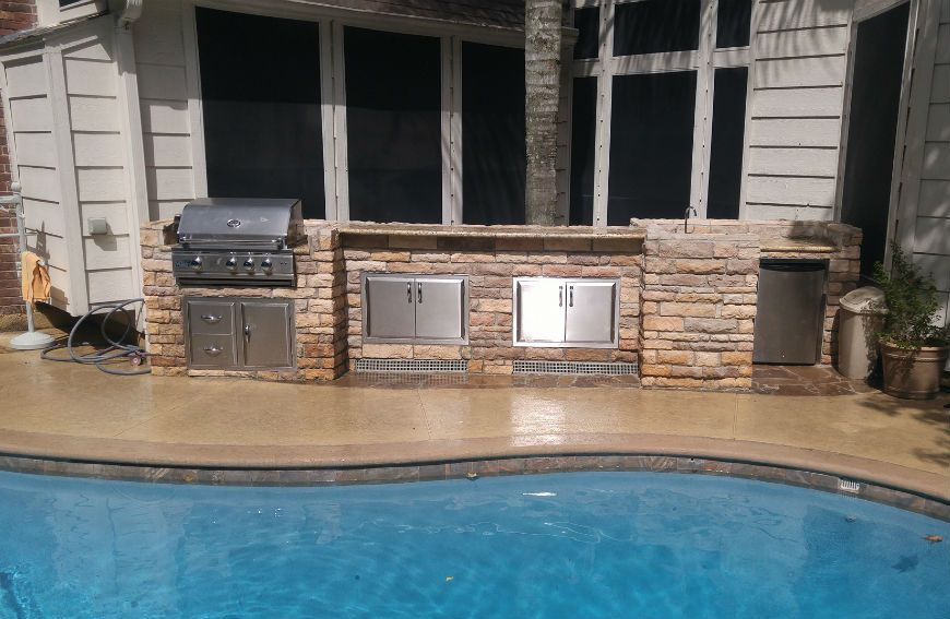 Pool designs with an outdoor kitchen photo