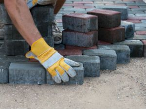 Man working on brick paver project