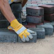 Man working on brick pavers project